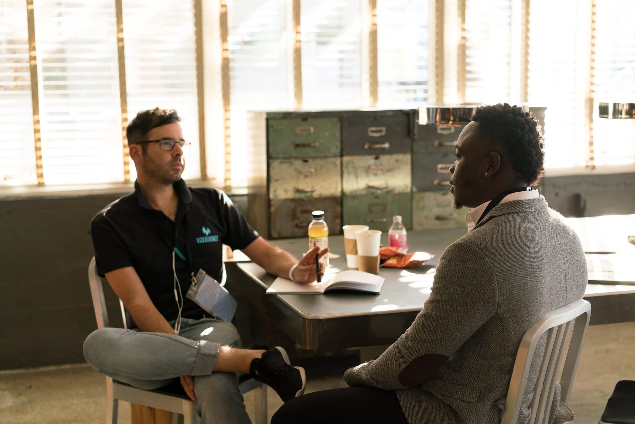 two-men-sitting-coaching